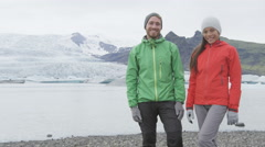 Portrait of multicultural happy couple on Iceland - man and woman looking Stock Footage