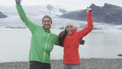 Cheering happy people celebrating on Iceland hike having fun - SLOW MOTION Stock Footage