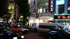 Time Lapse Pan of Busy Shinjuku Entertainment / Shopping District at Night Stock Footage