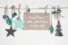 Merry christmas and a happy new year: xmas card with german text. Kuvituskuvat
