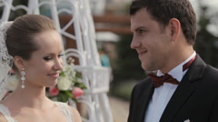 The groom kisses the bride in a beautiful wedding ceremony Stock Footage