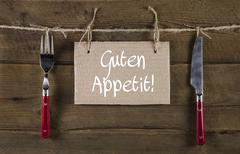 Bon appetite or enjoy your meal in german language. advertising sign with cut Stock Photos