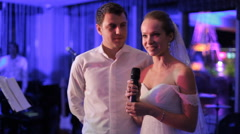 The bride at the wedding says touching words to guests - stock footage