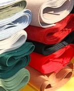 robust italian manufacture fabrics for sale in haberdashery - stock photo