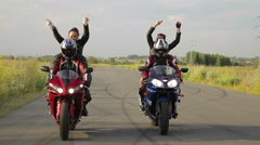 Dancing girl on a motorcycle Stock Footage