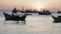 Traditional Vietnamese fishing boats in a small harbor at the sunset. Stock Footage