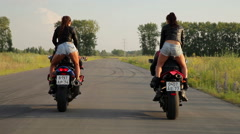 Dancing girl on a motorcycles Stock Footage