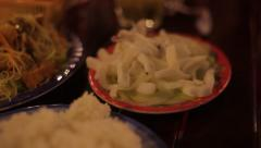 Traditional Vietnamese food: rice, noodles with meat (beef, chicken), squid. Stock Footage