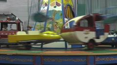 Children's fairground roundabout Stock Footage