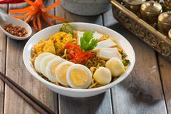 instant noodles soup, in curry flavour. hot and spicy. - stock photo