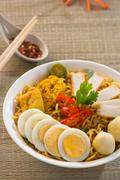 Instant noodles soup, in curry flavour. hot and spicy. Stock Photos