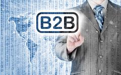 businessman pointing to word b2b - stock illustration