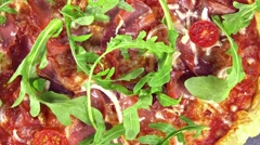 Homemade ham pizza with rocket (seamless loopable) Stock Footage