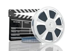 illustration of cinema clap and film reel, over white background - stock illustration