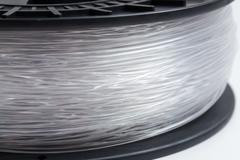 Filament for 3d printer crystal clear bright background Stock Photos