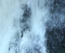 Heavy water flow splashing against rock, turning  into foam, click for HD Stock Footage