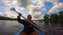 Young happy man actively paddling kayak, singing. Action camera, click for HD Stock Footage