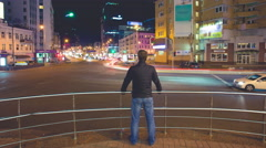 4K. Man stand by modern city landscape at night. Shot with Red Cinema Camera Stock Footage