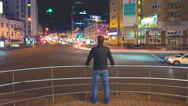 Stock Video Footage of 4K. Man stand by modern city landscape at night. Shot with Red Cinema Camera
