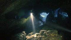 Stock Video Footage of scubadiver exploring underwater  cave