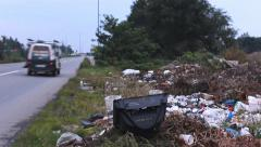 Dump trash by the road traffic near dump old television Stock Footage