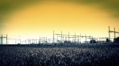 Sunset on electricity power station agriculture field Stock Footage