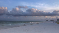 Stock Video Footage of Walkers on Clearwater beach at sunrise