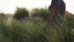 Model walking in the dunes. Stock Footage