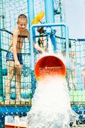boy having fun with water bucket - stock photo