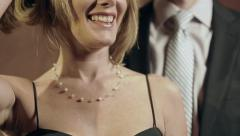 Well-dressed man helps date with her necklace - close-up shot Stock Footage