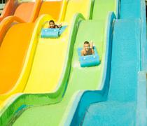 Two boys having fun in  waterslide Stock Photos