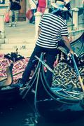 Gondolier on the docks awaiting tourists in venice, italy Kuvituskuvat