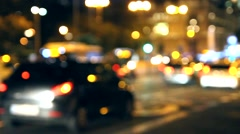 Out of focus lights of traffic on the streets of a city Stock Footage
