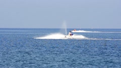 Tracking a man cruising the ocean on a jet ski motor Stock Footage