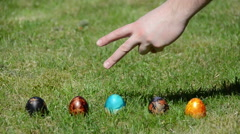 Traditional family Easter game with painted eggs on grass Stock Footage