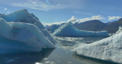 Aerial shot of Glacier Lake & Floating Ice Stock Footage