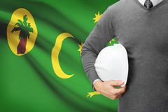 engineer with flag on background - territory of the cocos (keeling) islands - stock photo