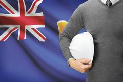 engineer with flag on background - turks and caicos islands - stock photo
