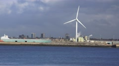 4k wind turbine at industrial sea front, Liverpool docks. Stock Footage