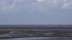 4k off shore wind turbines out at sea wind farm Stock Footage