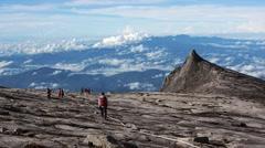 Climbers at the Top of Mount Kinabalu, Sabah, East Malaysia Stock Footage