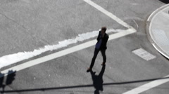 Shadow of a man crossing the stret - high angle - stock footage