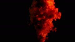 Red and yellow ink ascending like in a big explosion, black background - stock footage