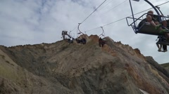 Chairlift going up a mountain - stock footage