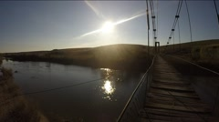 View of a River and bridge at sunset Stock Footage