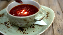 Borsch with sour cream served in cafe Stock Footage