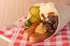 bangers and mash in a cone of flat bread - stock photo