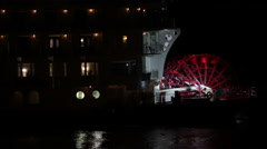 Paddle Boat Fights The Current Of Mississippi River At Night Stock Footage