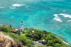 Aerial view of diamond head lighthouse with azure ocean in background Stock Photos