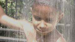 Funny Mixed Race Black and Latino Brazilian Little Boy Take Shower Stock Footage